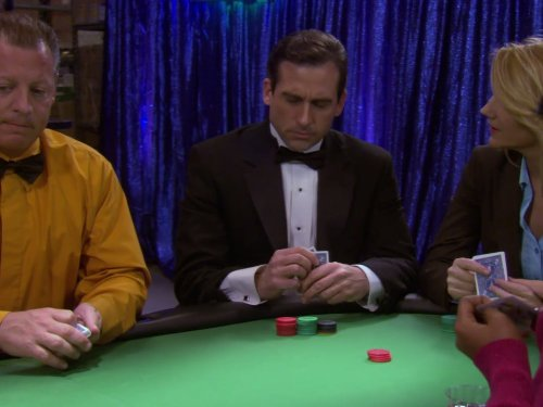 The Office TV show - Casino Night episode - picture of character Michael Scott holding cards.