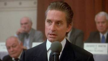 "Gordon Gekko from the film ""Wall Street"" explaining that ""greed is good."""
