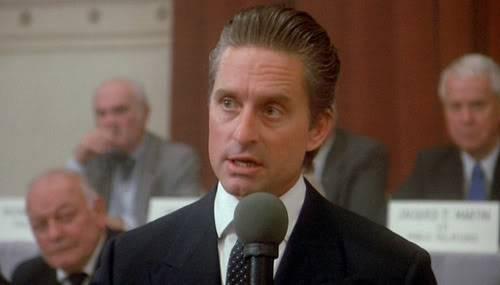 "Gordon Gekko from the film ""Wall Street"" explaining that ""greed is good."""