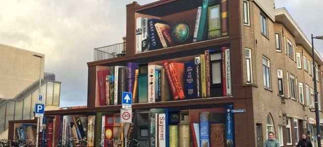 A mural of Dutch books on a building in Utrecht, Netherlands.