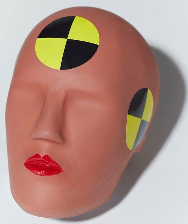 A feminine-looking crash test dummy head.