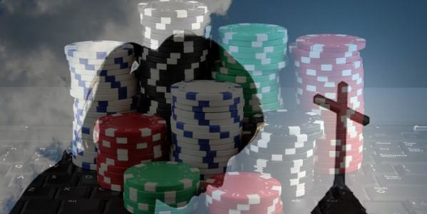 Pascal's wager image: person praying in front of a pile of poker chips.